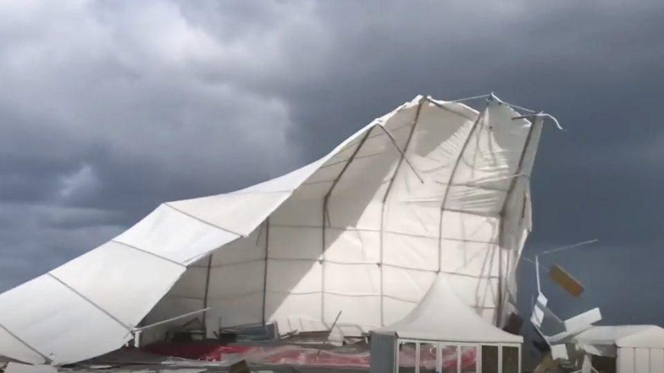 Wind lifts a hospitality tent into the air at St. Andrews.