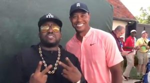 Tiger Woods and rapper Big Boi smile for the cameras at the Tour Championship.