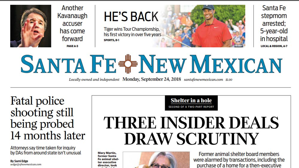 Tiger Woods on front page of Santa Fe New Mexican.