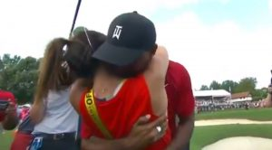 Tiger Woods embraces girlfriend Erica Herman after his Tour Championship win.
