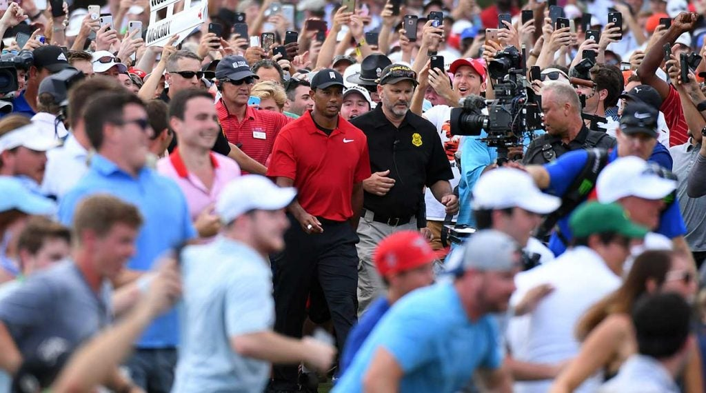 Woods had the crowd behind him, literally, on the 18th hole.