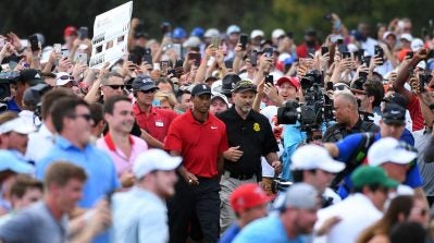 WATCH: Thousands of fans flood 18th fairway as Tiger Woods closes out the victory