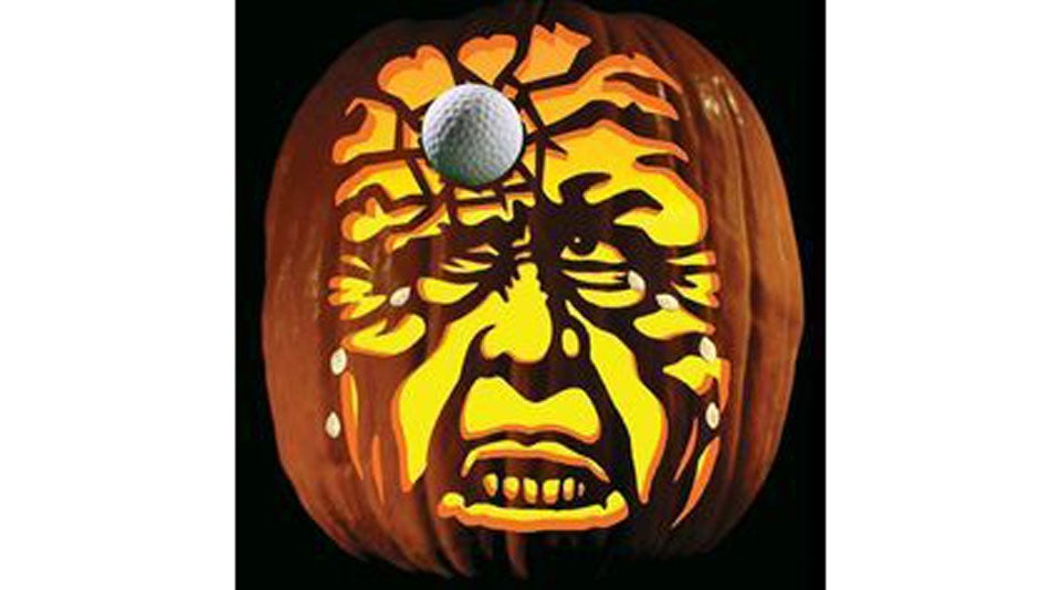 A classic spooky face, paired with a golf ball. Perfection!