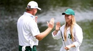 Ernie Els high-fives his daughter, Samantha, during the 2016 Masters Par 3 Contest.