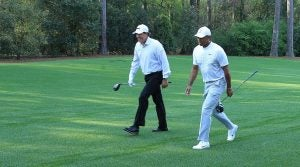 Phil Mickelson and Tiger Woods walk down the fairway at Augusta National.