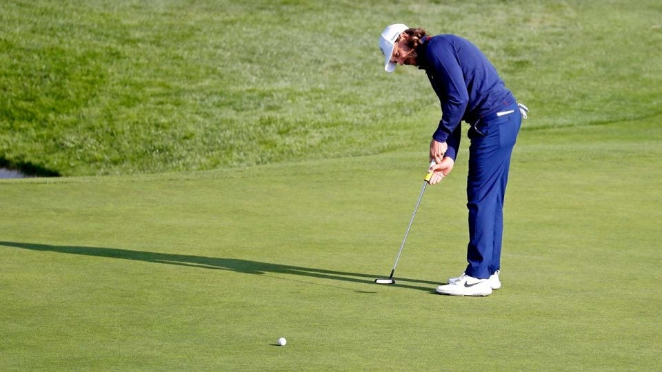 Tommy Fleetwood putts with the claw grip during the 2018 Ryder Cup.