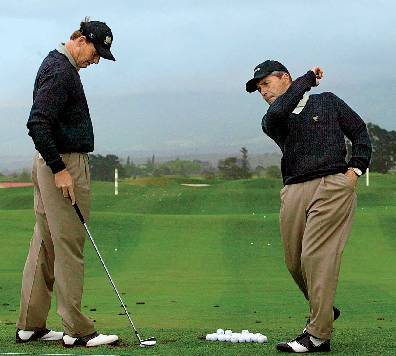 Ernie Els and Gary Player on the driving range.