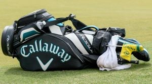 Marc Leishman's golf bag lies on the grass Sunday in the final round of the 2018 CIMB Classic.