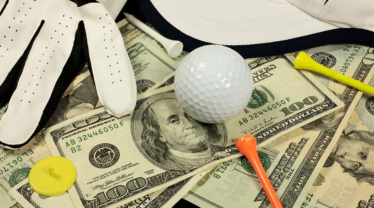 Golf ball and tee on stack of money.