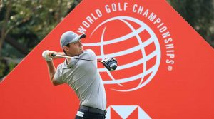 Rory McIlroy watches his tee shot during WGC-HSBC Champions practice round.