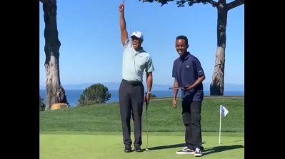 WATCH: Tiger Woods and his young mentee sink hands-free putt with robotic ball