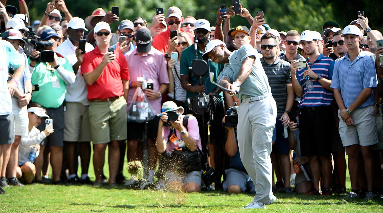 Tiger Woods watches his ball at the 2018 Tour Championship.