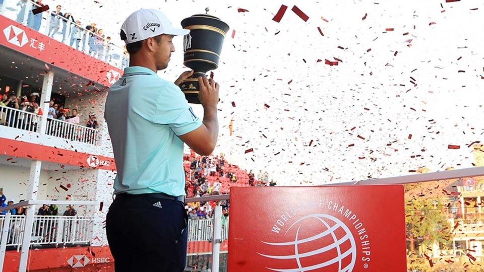 Xander Schauffele holds up the trophy after winning the WGC-HSBC Champions.