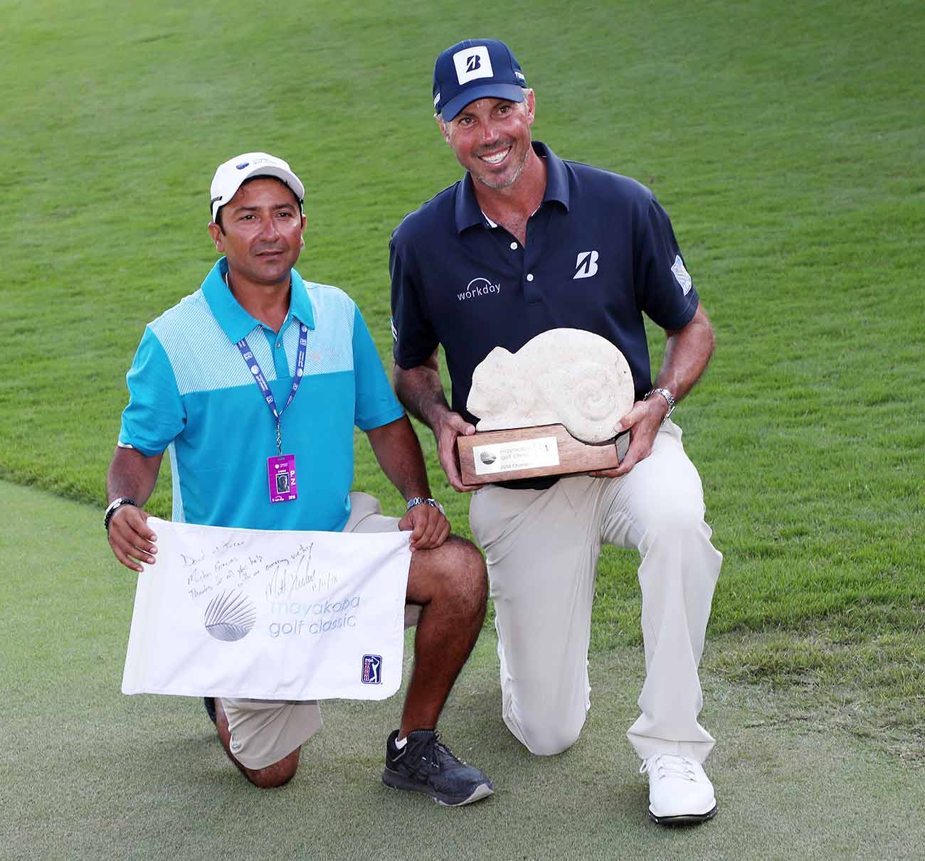 Matt Kuchar and El Tucan pose for a photo after their win. El Tucan said he cried when he held the trophy.