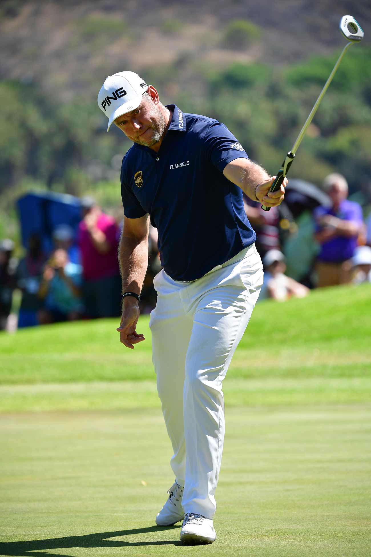 Lee Westwood holds up his putter during a stellar final round on Sunday.
