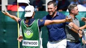 Lee Westwood hugs girlfriend and caddie Helen Storey after winning the Nedbank Golf Challenge on Sunday.