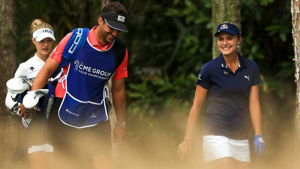 Lexi Thompson and her brother and caddie walk off the tee on Sunday.