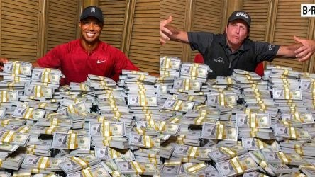 Tiger Woods and Phil Mickelson stand over huge stacks of money to promote their match.