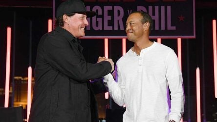 Tiger Woods and Phil Mickelson shakes hands during the afterparty for The Match.