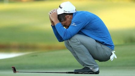 Charles Howell III crouches after making birdie to win the RSM Classic on Sunday.