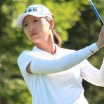 Doris Chen watches a tee shot.