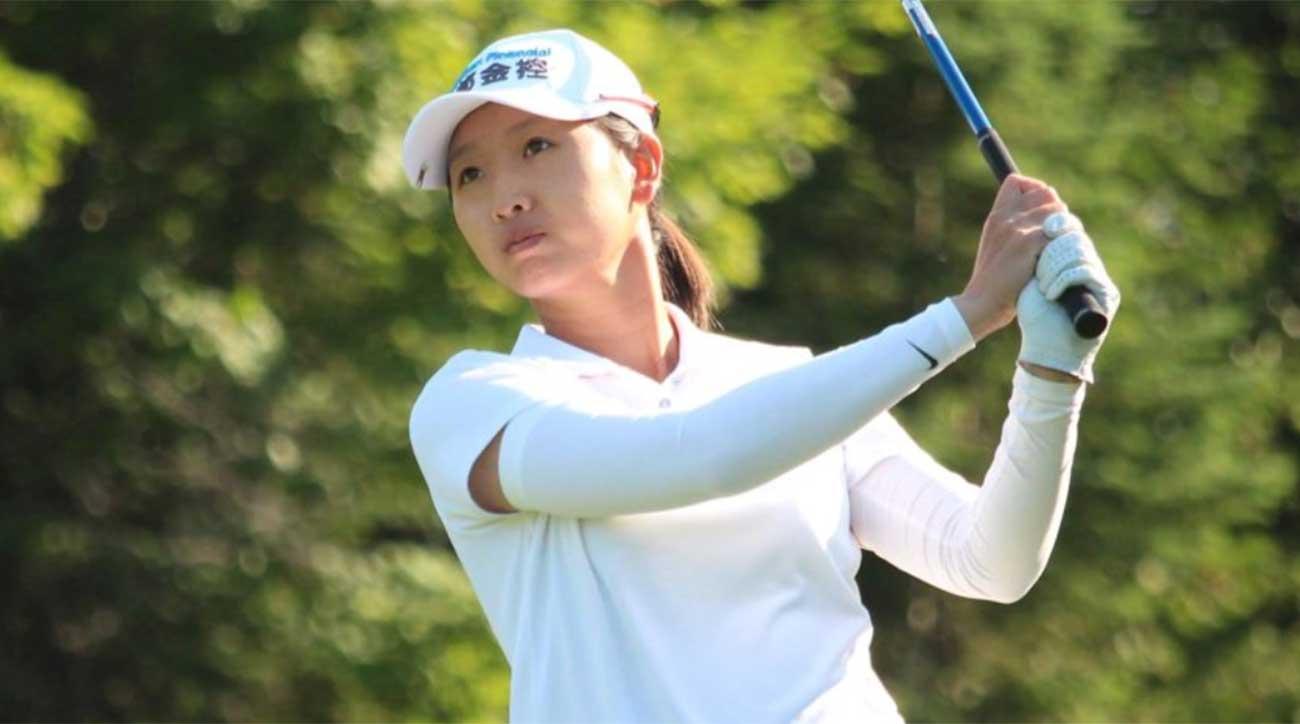 Doris Chen watches a tee shot.