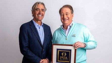Howard Milstein and PGA of America CEO Seth Waugh pose for a photo.