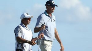 Matt Kuchar and his caddie, El Tucan, walk down the fairway at the Mayakoba.