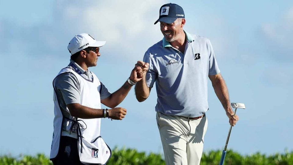 Matt Kuchar and his local caddie, David, celebrate a shot during the Mayakoba.