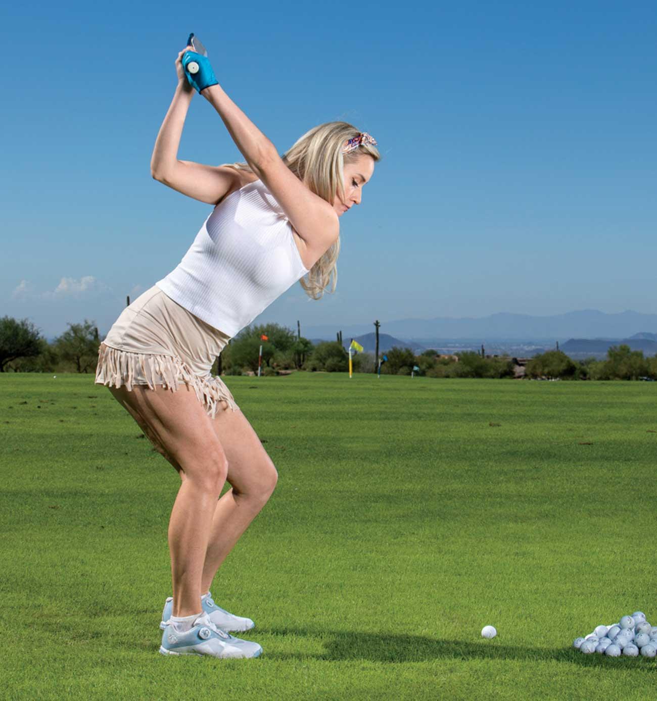 Paige Spiranac takes aim on the range.