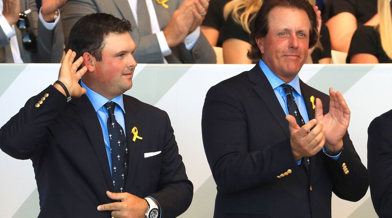 Patrick Reed stands next to Phil Mickelson during the opening ceremony for the 2018 Ryder Cup at Le Golf National.