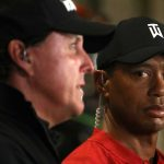 Tiger Woods stares at Phil Mickelson during their Tuesday press conference for The Match.