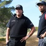 Phil Mickelson and Tiger Woods look on during The Match on Friday at Shadow Creek.