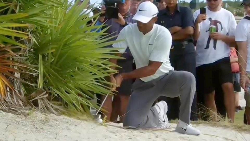Tiger Woods hits his second shot on the 18th hole during the second round of the Hero World Challenge.