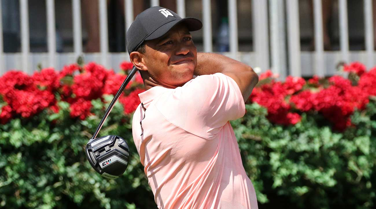 Tiger Woods watches a drive off the tee.