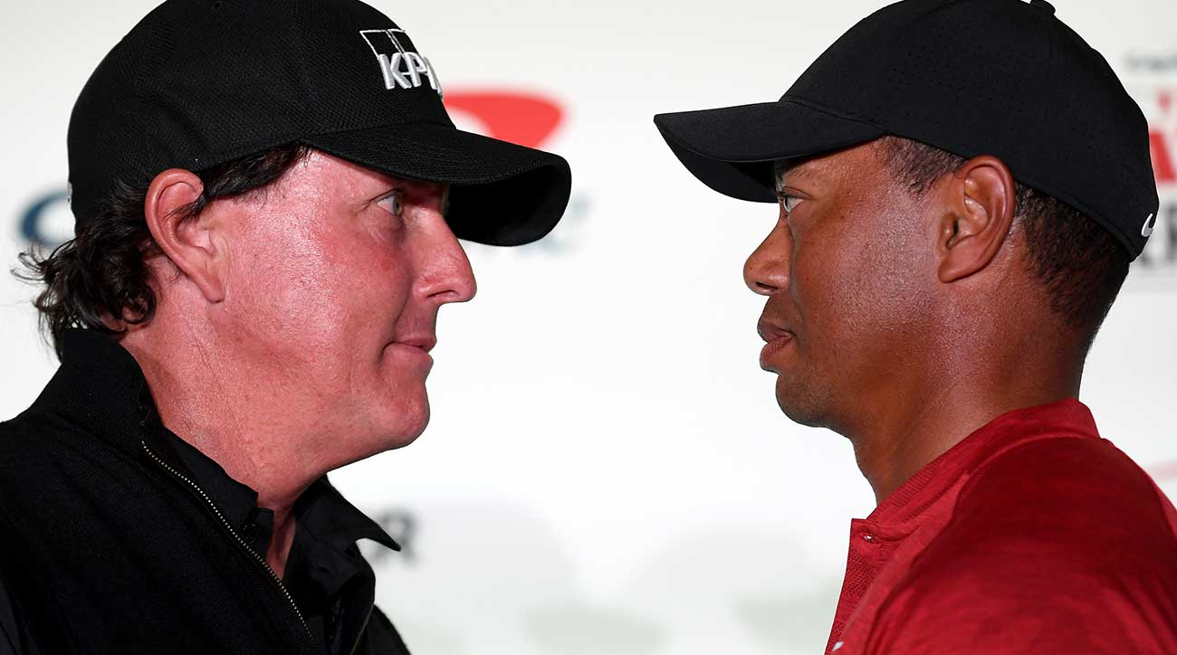 Phil Mickelson and Tiger Woods trade stares at The Match press conference on Tuesday.
