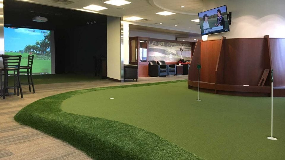 The putting green and a simulator at PGA MSP Airport.