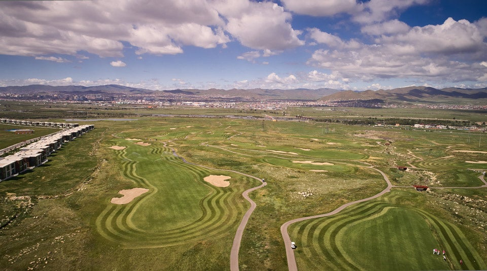 An aerial view of Mt. Bogd golf course, with Ulaanbaatar visible in background.
