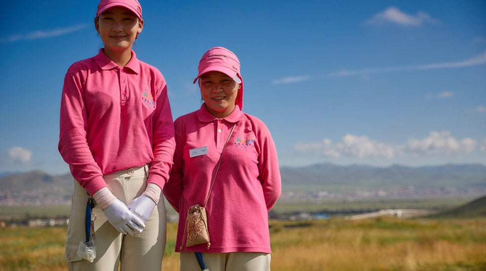 Ollie's caddie (right) and the other caddie in the group (left). All the caddies in Mongolia are female, and all are taught golf themselves.