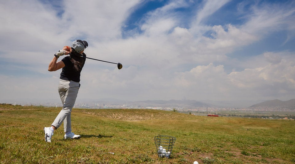 Bilgee warming up for her own Mongolian National Open campaign, after already caddying in the men's division that morning.