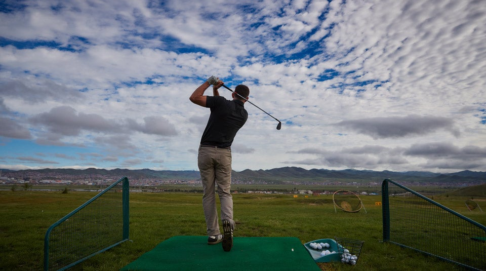 The author warming up on the Mt. Bogd driving range before the opening round of the Mongolian National Open.