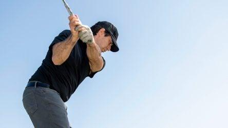 Alan Shipnuck takes some iron swings at a driving range.