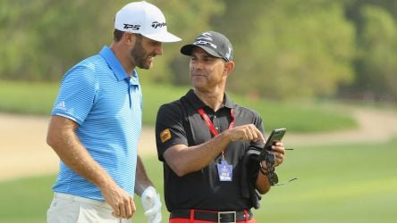 Instructor Claude Harmon III and Dustin Johnson.