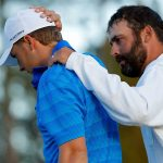 Caddie Michael Greller consoles Jordan Spieth after the 2016 Masters.