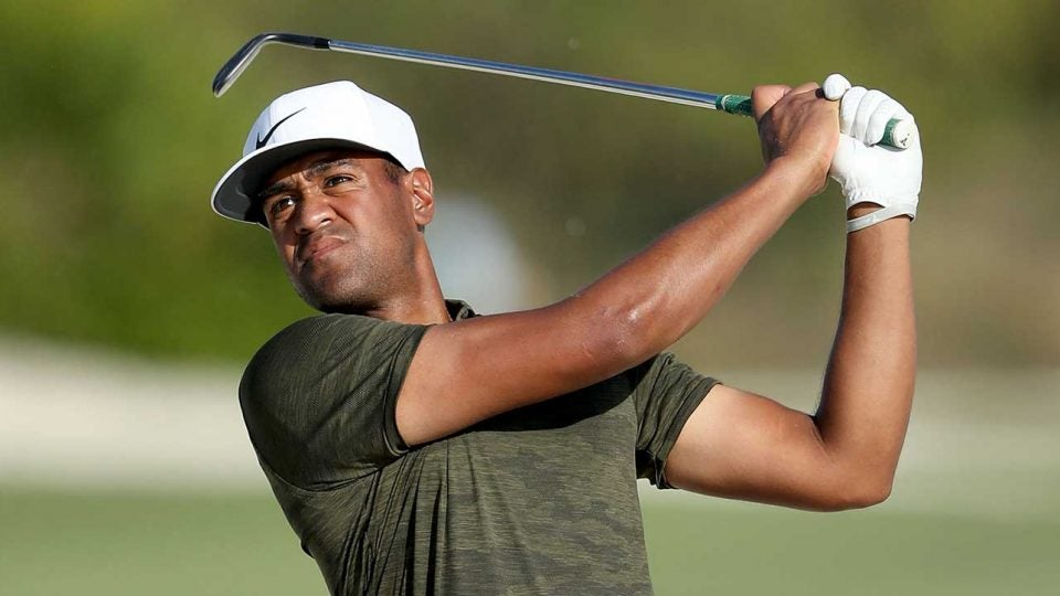 Tony Finau watches a shot during a tournament.