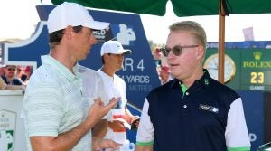 Rory McIlroy speaks with Keith Pelley, CEO of the European Tour, during the 2018 DP World Tour Championship.