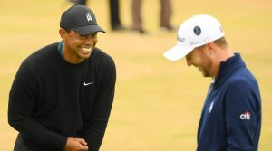 Tiger Woods and Justin Thomas laugh during a practice round at the 2018 Open Championship