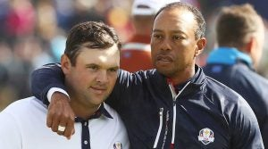 Patrick Reed and Tiger Woods walk off the green at the 2018 Ryder Cup.
