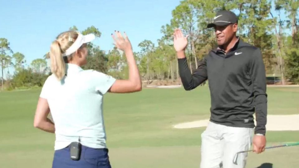 Lexi Thompson and TOny Finau high-five after competing against each other prior to the QBE Shootout.