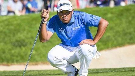 Hideki Matsuyama lines up a putt